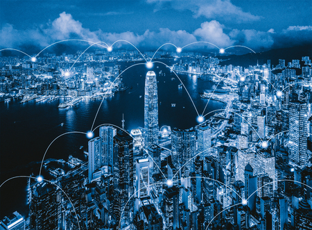 Digital network connection lines of Hong Kong Downtown. Financial district and business centers in smart city in technology concept. Skyscraper and high-rise buildings. Aerial view at night