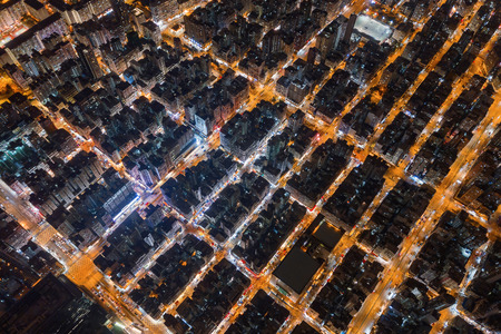 Aerial view of intersection in Sham Shui Po, Shek Kip Mei, Hong Kong Downtown. Financial district and business centers in smart city, technology concept. Top view of buildings at night.