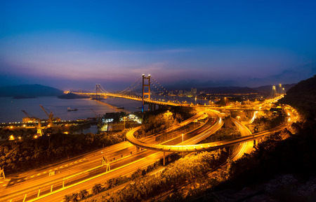 Tsing Ma Bridge. Highways in Hong kong with structure of suspension architecture in transportation and travel concept, Urban city at night. Stockfoto