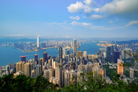 Hong Kong Downtown from Victoria Peak. Financial district and business centers in smart city and technology concept. skyscraper and high-rise office buildings with blue sky.