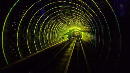 Shuttle trains in Bund Sightseeing Tunnel. Metro subway train in Shanghai City, China. Tunnel of lights under Huangpu River is one of Shanghai's top five tourist attractions