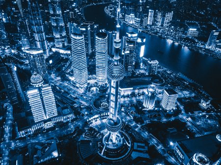 Aerial view of Shanghai Downtown, China. Financial district and business centers in smart city in Asia. Top view of skyscraper and high-rise buildings at night. 版權商用圖片 - 122179356