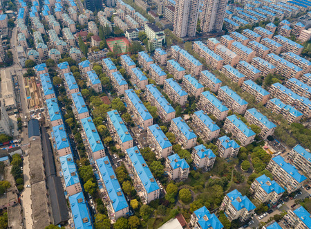 Aerial view of blue houses. Residential neighborhood. Urban housing development from above. Top view. Real estate in Shanghai City, China