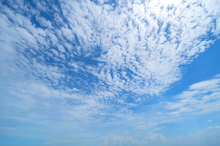 Clear blue sky with white fluffy clouds. Nature background. Standard-Bild - 124873567