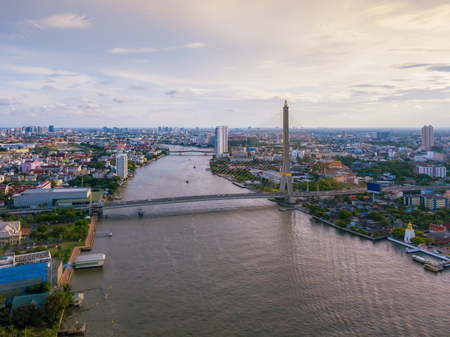 Aerial view of buildings with Chao Phraya River in transportation concept. Bangkok skyline background, Urban city in downtown area at sunset, Thailand. 스톡 콘텐츠