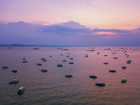 Aerial view of boats in Pattaya sea, beach with sunset sky for travel background. Chonburi, Thailand. Фото со стока