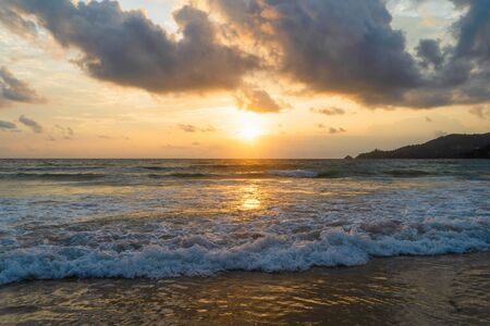 Wave at Phuket beach, Andaman Sea at sunset in Thailand. Nature sky background.