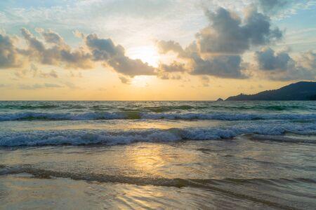 Wave at Phuket beach, Andaman Sea at sunset in Thailand. Nature sky background. Фото со стока - 124875030