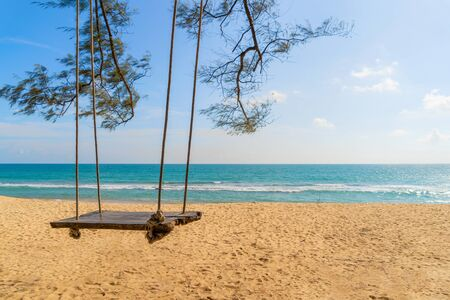 A swing near the beach for travel trip and holidays vacation outdoors background. Ocean or nature sea at noon, Phuket, Thailand