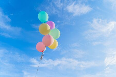 Colorful balloons isolated on clear blue sky background in happy birthday, celebration party concept. Фото со стока - 124875114