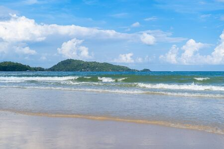 Wave at Phuket beach, Andaman Sea at noon in Thailand. Nature sky background.