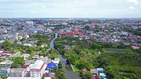 Aerial view of Bang Khun Thian Canal with nature trees, Wutthakat district, Bangkok City, Thailand in urban city in Asia. Residential houses, buildings at noon. Imagens - 124868046