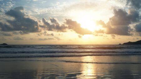 Wave at Phuket beach, Andaman Sea at sunset in Thailand. Nature sky background. Фото со стока - 124875058
