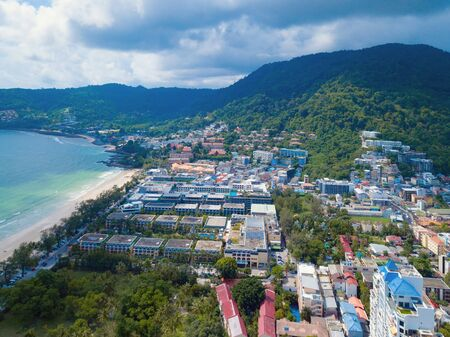Aerial view of Patong beach, Phuket island and sea in summer, and urban city with blue sky for travel background, Andaman ocean, Thailand.