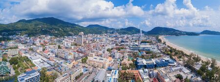 Aerial view of Patong beach, Phuket island and sea in summer, and urban city with blue sky for travel background, Andaman ocean, Thailand. Фото со стока - 124875057