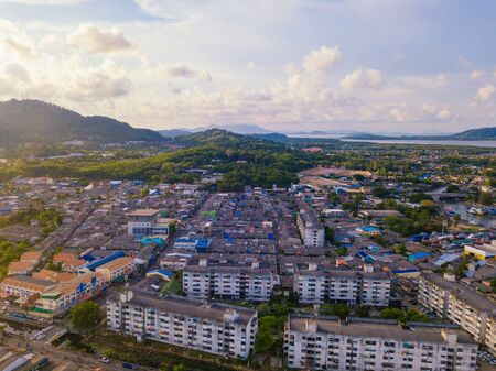 Aerial view of residential houses near Phuket beach island and sea in summer, and urban city with blue sky for travel background, Andaman ocean, Thailand. Imagens - 124874691