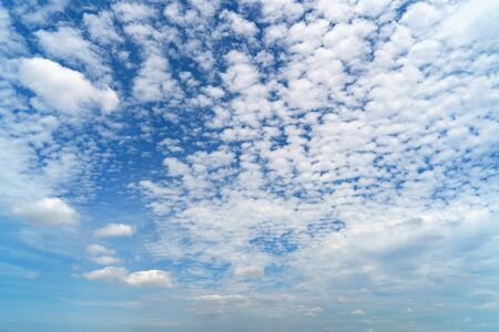 Clear blue sky with white fluffy clouds. Nature background. Standard-Bild - 124868565