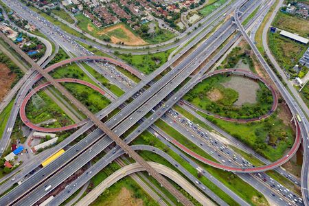 Aerial view of highway junctions. Bridge roads shape number 8 or infinity sign in structure of architecture concept. Top view. Urban city, Bangkok, Thailand.