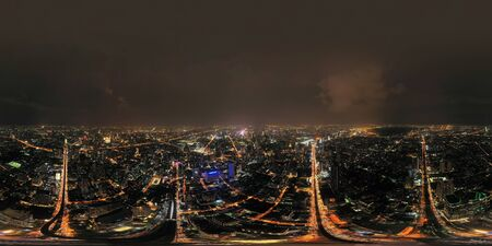 360 panorama by 180 degrees angle seamless panorama view of Sathorn intersection or junction with cars traffic, Bangkok Downtown. Thailand. Financial district and centers in smart urban city at night.