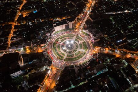 Wongwian Yai roundabout. Aerial view of highway junctions. Roads shape circle in structure of architecture and technology transportation concept. Top view. Urban city, Bangkok at night, Thailand.