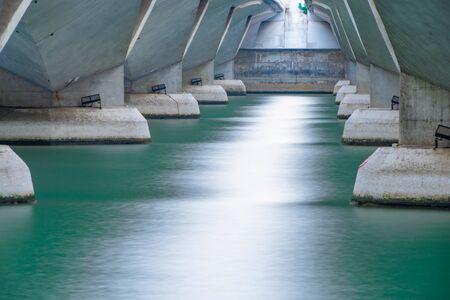 Reflection under Bridge in structure of architecture concept, urban city, Downtown area. Monochrome image.