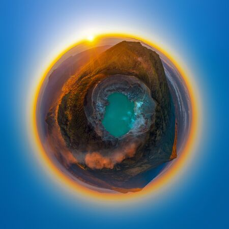 Little planet 360 degree sphere. Panorama of Aerial view of Kawah Ijen volcano with turquoise sulfur water lake at sunrise. Panoramic view at East Java, Indonesia. Natural landscape background.