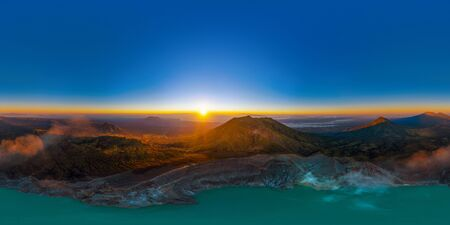 360 panorama by 180 degrees angle seamless panorama view of aerial view of Kawah Ijen volcano with turquoise sulfur water lake at sunrise. Panoramic view at East Java, Indonesia. Natural landscape.