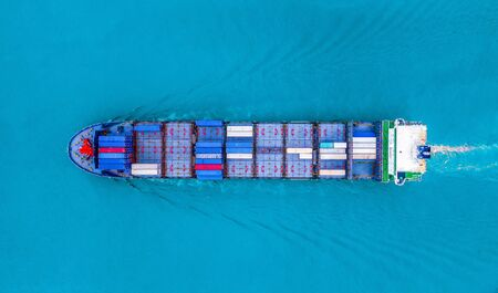 Aerial top view of container cargo ship in the export, import business, logistics and transportation concept with international goods on the blue ocean.