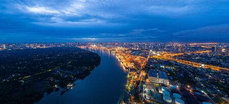 Aerial view of container cargo ship in the export, import business, logistics and transportation. International goods in urban city. Shipping to the harbor by crane in Bangkok City, Thailand at night. Stok Fotoğraf - 132118493