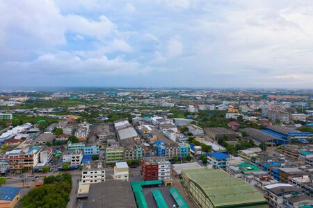 Aerial top view of residential buildings in Bangkok, Thailand. Urban city in Asia at noon. Landscape background. 写真素材 - 129509287