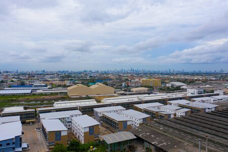 Aerial top view of residential buildings in Bangkok, Thailand. Urban city in Asia at noon. Landscape background.