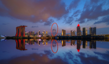 Singapore Downtown skyline at night with reflection. Financial district and business centers in technology smart urban city in Asia. Skyscraper and high-rise buildings. Editorial