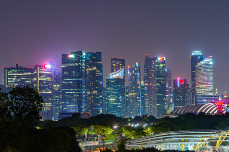 Singapore Downtown skyline at night. Financial district and business centers in technology smart urban city in Asia. Skyscraper and high-rise buildings.