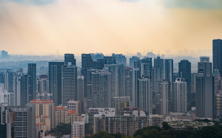 Aerial view of Singapore Downtown skyline at sunset. Financial district and business centers in technology smart urban city in Asia. Skyscraper and high-rise buildings.