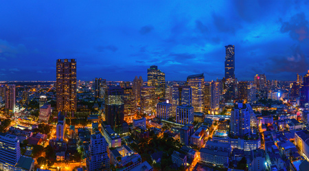 Aerial view of Bangkok Downtown Skyline. Thailand. Financial district and business centers in smart urban city. Skyscraper and high-rise office buildings at night.