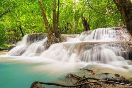 Huay Mae Khamin Waterfall with trees. Nature landscape of Kanchanaburi district in natural area. it is located in Thailand for travel trip on holiday and vacation background, tourist attraction. Banco de Imagens - 132117587
