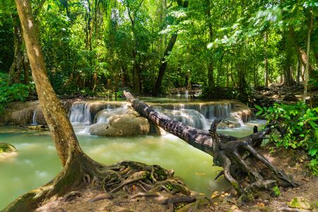 Erawan Waterfall. Nature landscape of Kanchanaburi district in natural area. it is located in Thailand for travel trip on holiday and vacation background, tourist attraction. Banco de Imagens - 132117117
