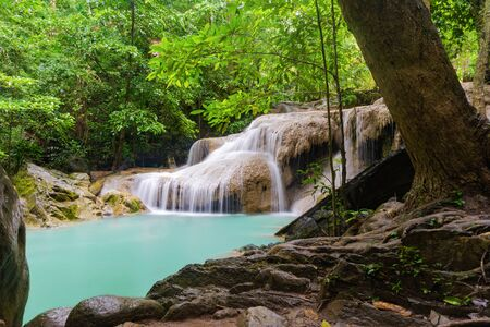 Erawan Waterfall. Nature landscape of Kanchanaburi district in natural area. it is located in Thailand for travel trip on holiday and vacation background, tourist attraction.