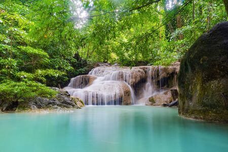Erawan Waterfall. Nature landscape of Kanchanaburi district in natural area. it is located in Thailand for travel trip on holiday and vacation background, tourist attraction. Banco de Imagens - 132117708