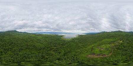 360 panorama by 180 degrees angle seamless panorama of aerial view of trees in tropical forest in national park and mountain or hill in summer season in Kanchanaburi district, Thailand. Landscape.