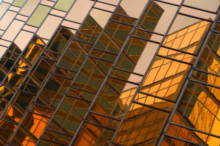 Golden building. Windows glass of modern office skyscrapers in technology and business concept. Facade design. Construction structure of architecture exterior for urban cityscape background.