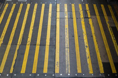 Aerial top view of empty walking street with zebra crossing or pedestrian crossing. Business traffic road in urban city, Hong Kong Downtown, Republic of China. Banco de Imagens