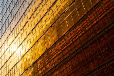 Golden building. Windows glass of modern office skyscrapers in technology and business concept. Facade design. Construction structure of architecture or engineering. Exterior for urban city background
