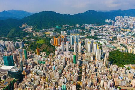 Aerial top view of Hong Kong Downtown, republic of china. Financial district and business centers in smart urban city in Asia. Skyscrapers and high-rise modern buildings at noon.
