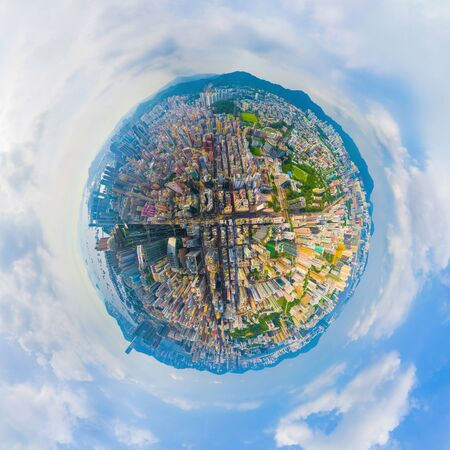 Little planet 360 degree sphere birds eye view. Panoramic view of aerial view of Hong Kong Downtown. Financial district and business centers in technology smart urban city. Skyscraper buildings. Banco de Imagens - 130495495