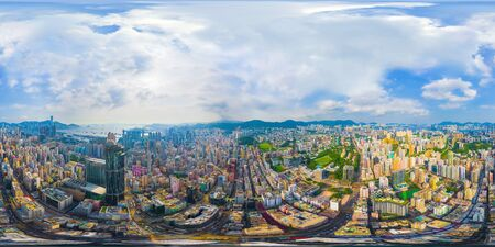360 panorama by 180 degrees angle seamless panorama view of aerial view of Hong Kong Downtown. Financial district and business centers in technology smart city. skyscraper and buildings at noon. 写真素材