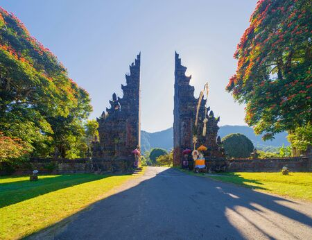 The famous Bali Handara. The Hindu Temple with ancient gate with pathway in park garden at noon. Hindu architecture landscape background of travel trip and holidays vacation in Indonesia.