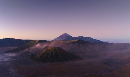 Aerial view of Mount Bromo at sunrise. An active volcano, one of the most visited tourist attractions in east Java from viewpoint, Indonesia. Natural landscape background.