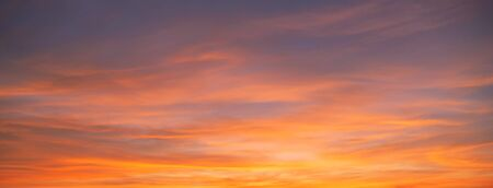 Sunset sky. Abstract nature background. Dramatic blue and orange, colorful clouds at twilight time. Stock Photo