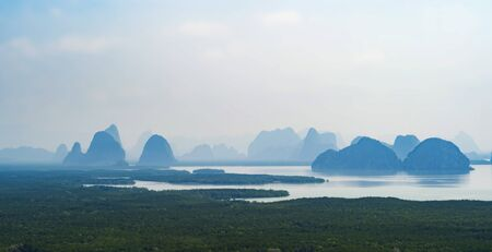 Samet Nangshe Viewpoint at sunset with Andaman sea in Phang Nga Bay, tourist attraction in summer season, Thailand in travel trip and holidays vacation. Natural landscape wallpaper background.